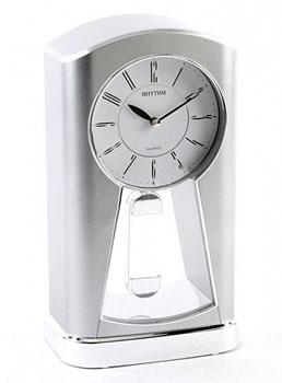 Rhythm Настольные часы  Rhythm 4RP794WR19. Коллекция Century кинг с ветер сквозь замочную скважину