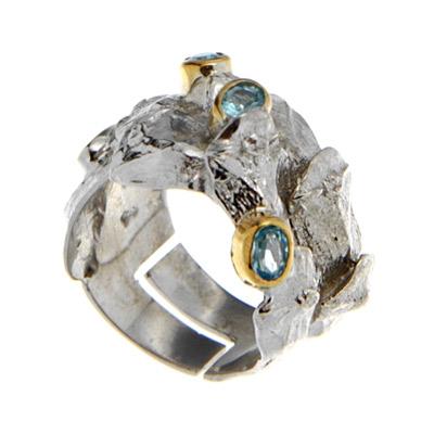 Купить Серебряное кольцо 1152t, Кольцо Beavers, Серебро с родиевым покрытием. Примерный вес изделия - 9, 6 гр. Вставка: Топаз., Ювелирное изделие